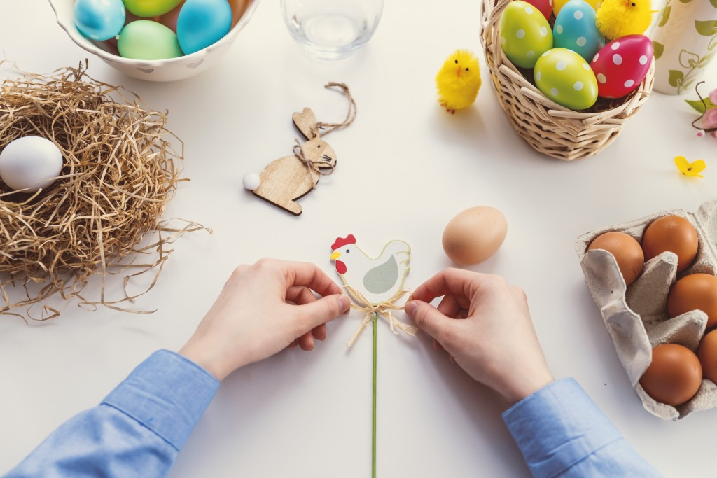 colorful Easter crafts wooden chicken eggs and rabbit