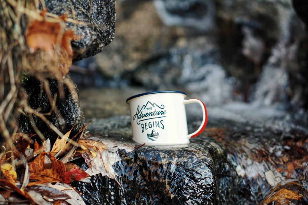 white mug with adventure motif