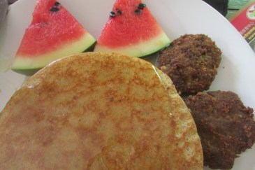 A very hearty breakfast - gingerbread pancakes with watermelon and homemade sausage