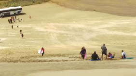 Sand boarding down the Te Paki Dunes