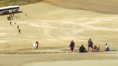Sand boarding down the Te Paki Dunes