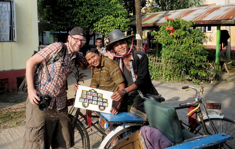 In Burma, these brothers insisted I join them for a photo with Taksi.
