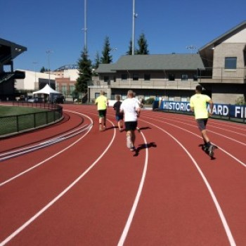 and finish with a lap of the track in historic Hayward Field!  A runner's dream come true!  The boys let me lead the way for the first 250, then their competitive sides kicked in and they left me in the dust, of course!  This photo was taken just seconds before UIH reminded everyone that he's still the fastest one in the family.