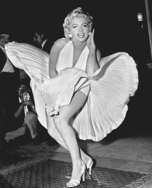 "Marilyn Monroe poses over the updraft of New York subway grating while in character for the filming of ""The Seven Year Itch"" in Manhattan on September 9, 1954.  The former Norma Jean Baker modeled and starred in 28 movies grossing $200 million. Sensual and seductive, but with an air of innocence, Monroe became one of the world's most adored sex symbols. She died alone by suicide, at age 36 in her Hollywood bungalow.  (AP Photo/Matty Zimmerman)"