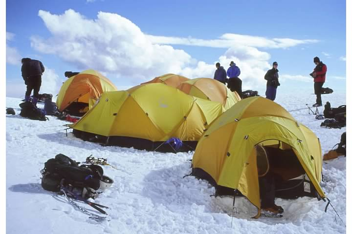 Tents on the snow, perhaps above a crevasse
