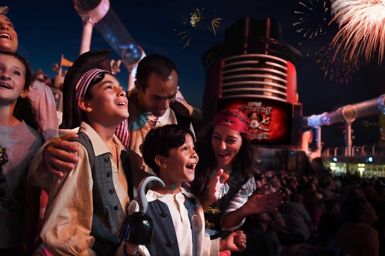 Family fun and fireworks at sea during Pirate Night aboard a Disney Cruise Line ship
