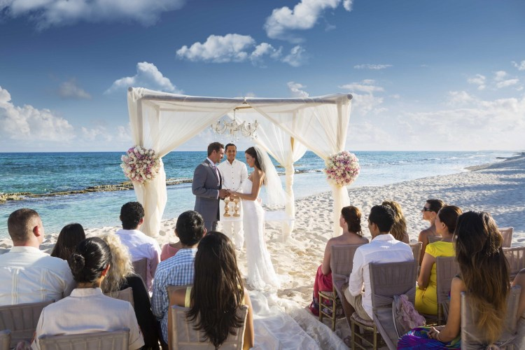 Destination Wedding ceremony on beach at an all inclusive El Dorado Resort in Mexico