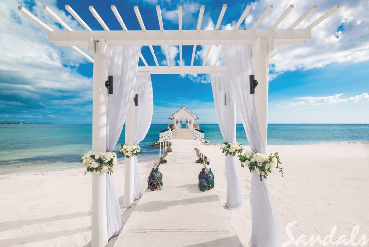 Destination wedding over-water chapel at an all inclusive Sandals resort