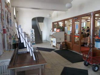 The lobby area of the Potsdam Public Library. The staircase goes up to the box seats seen in the previous image.