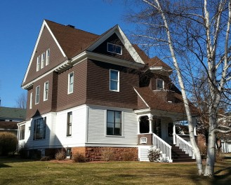 This house is located in Potsdam, NY on the corner of Leroy and Pleasant Streets. I don't know a lot about the history of the home but I consider it a local example of the shingle-style. The second and third floors are clad in shingles.
