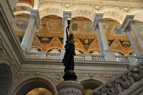 "I'm standing in the Great Hall of the Library looking upwards to the second floor. The bronze statue is about 8 feet tall and is a ""torchbearer"" raising a ""lamp of learning."""