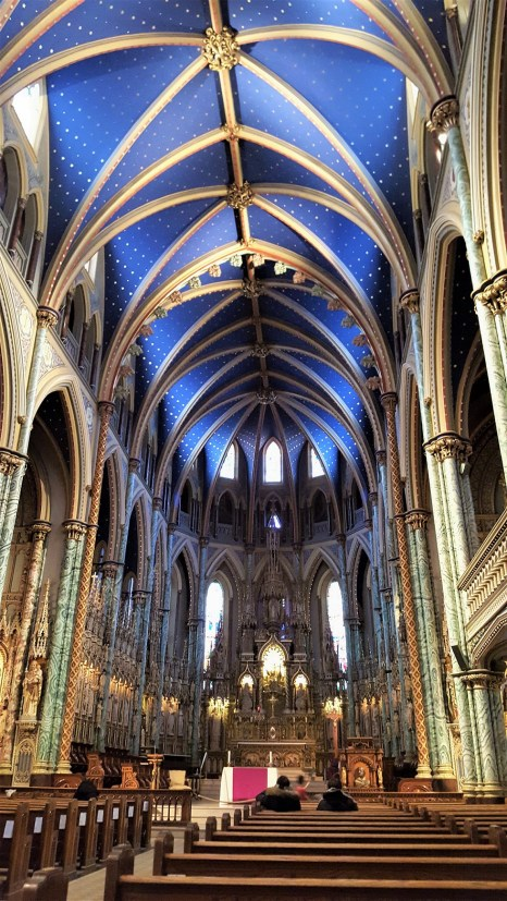 The interior of the Basilica was planned by Canon Georges Bouillon. A team of craftsmen, sculptors, and carpenters made the plans a reality. The ceiling is based on 16th century Gothic Style and the stars are gold-leaf. It was restored in 1999!