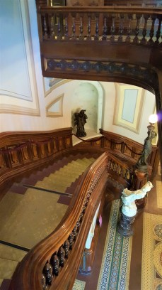 Walking through the front doors of the Crocker Mansion brings you into a foyer where there are double staircases leading to the second floor. This is a view of one of the staircases.