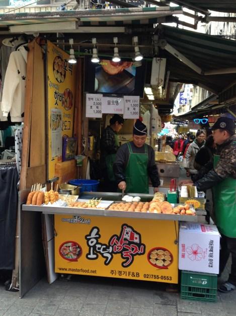 Making hotteok at Namdaemun Market.