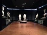 Room full of giant Buddhas.