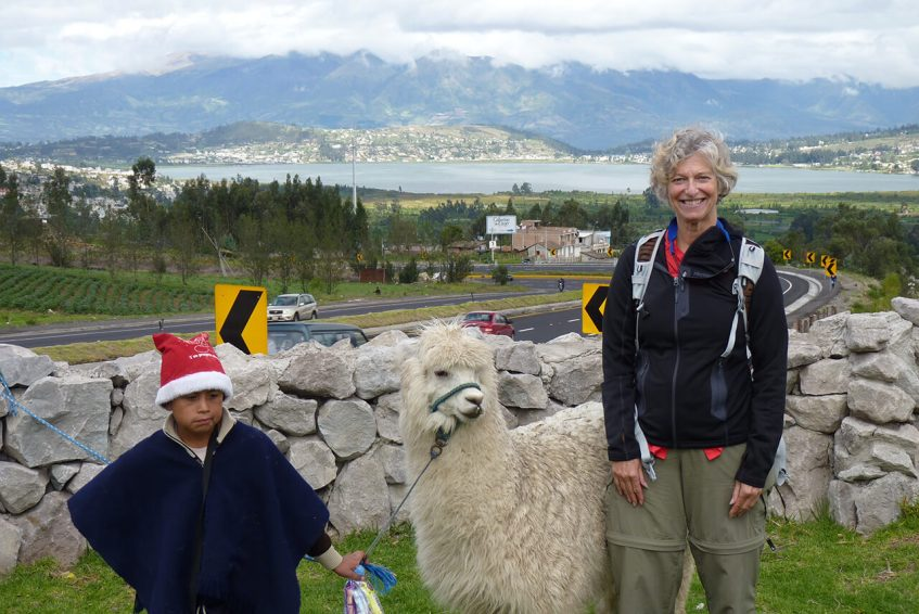 Kichwa boy showing off his alpaca, with Lake San Pablo in the background.