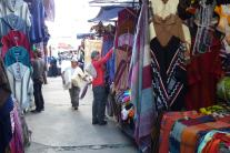 Shopping for shawls at the Otavalo market.