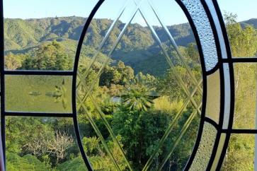 Abel Tasman viewed thru cut glass window from Marahau