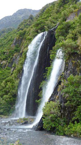 Waterfalls feeding into the Franz Josef Glacier valley