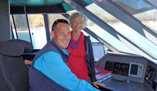 Wineglass Bay Cruises Captain Paul with Wendy on the bridge of Schouten Passage II
