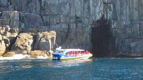 Tasman Island Pennicott Wilderness Journeys tour boat approaching sea cave
