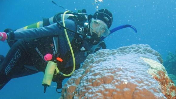 Wendy behind coral