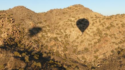 Hot Air Expeditions - Balloon shadows on the hills