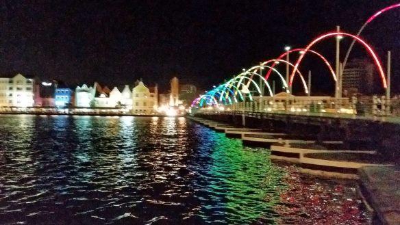 Queen Emma floating bridge, illuminated at night.