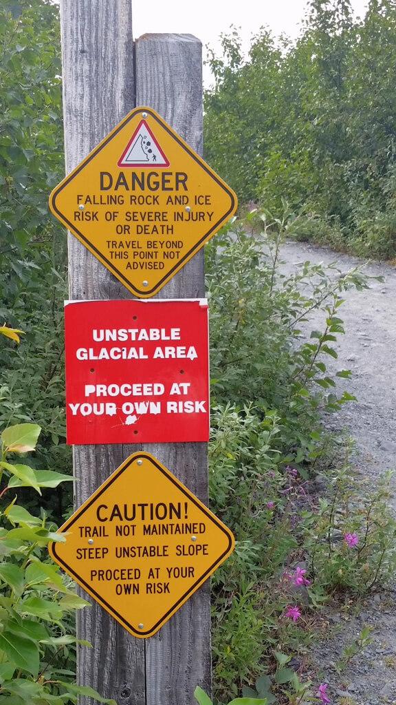 Warning sign at entrance to glacier trail