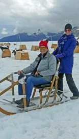 Wendy and Tom pose for pictures while on a dog mushing encounter