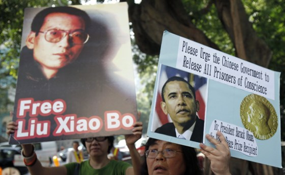 A demonstrator holds a picture of Chinese dissident Liu Xiaobo during a protest outside the US Consulate General in Hong Kong