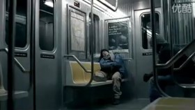 Tencent 2011 Chinese New Year Advertisement: Son abroad asleep on New York subway.