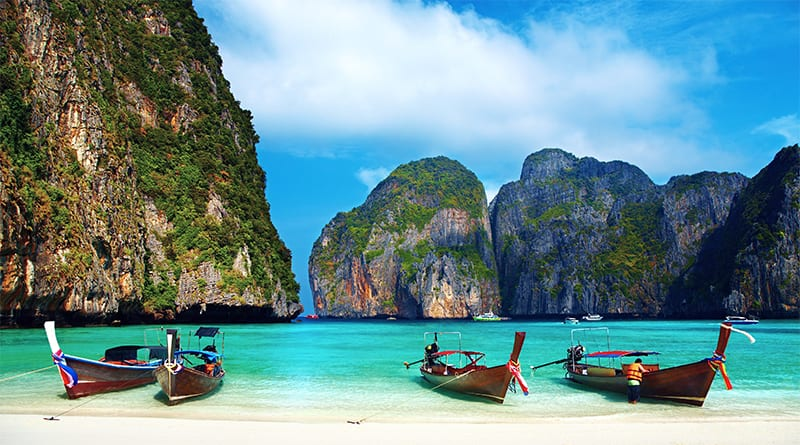 Tropical beach, traditional long tail boats, famous Maya Bay, Thailand
