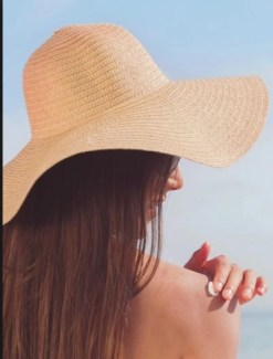 a young woman applying sunblock