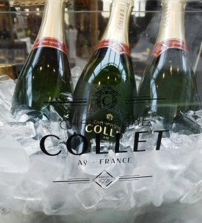 a bunch of champagne bottle from Collet on ice
