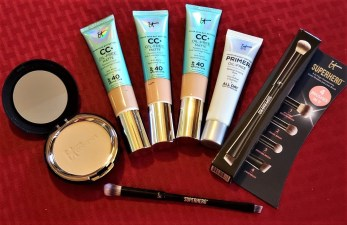 face products ITcosmetics CC cream primer and foundation plus a makeup brush photo by alison blackman