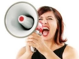 woman with a big mnouth and amegatphone yelling