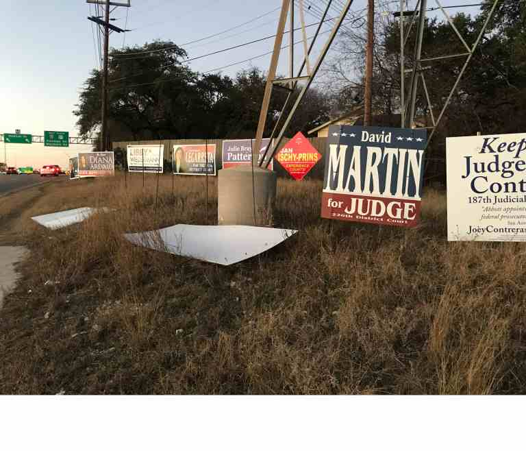 torn down political signs