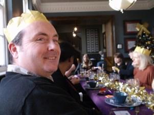 The boss in festive hat