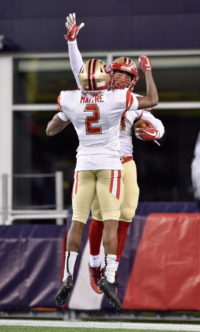Jason Maitre and Anthony Norcia of Everett celebrate a touchdown during their 35-10 MIAA Div. 1 Super Bowl win over Xaverian at Gillette Stadium, Saturday, Dec. 2, 2017.