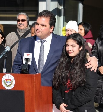 City officials stand with local immigrant community --- Mayor Carlo DeMaria took Araceli Flores, a seventh grade Madeline English School student and the daughter of parents under the Temporary Protected Status (TPS) program, under his arm at a rally in support of Everett's immigrant community outside City Hall on Tuesday, November 28. Two weeks later, the City Council passed a resolution calling on Congress to restore legal status to immigrants formerly protected under the TPS and Deferred Action for Childhood Arrivals (DACA) programs.