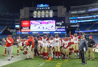 Players on the Everett sidelines cheer after stopping Xaverian at the goal line late in the third quarter during their 35-10 MIAA Div. 1 Super Bowl win at Gillette Stadium, Saturday, Dec. 2, 2017.