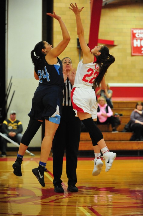 Saugus' Molly Granara and Peabody's Liz Zaiter fight for the ball during the tip off. (Advocate photos by Laura Jolly)