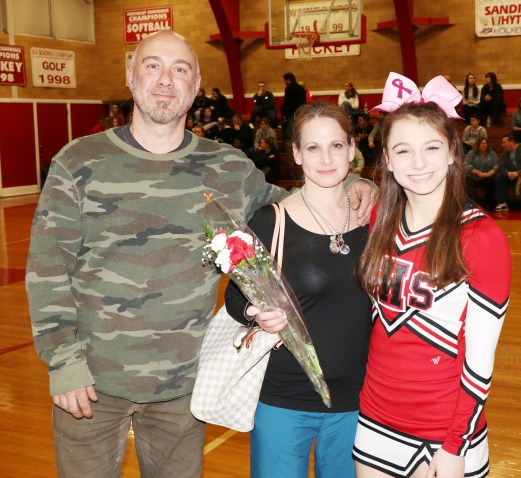 Sarah Trabucco with her parents, Kimberly and Roger.