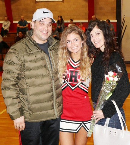 Capt. Britney Miranda with her parents, Jenn and Mike.