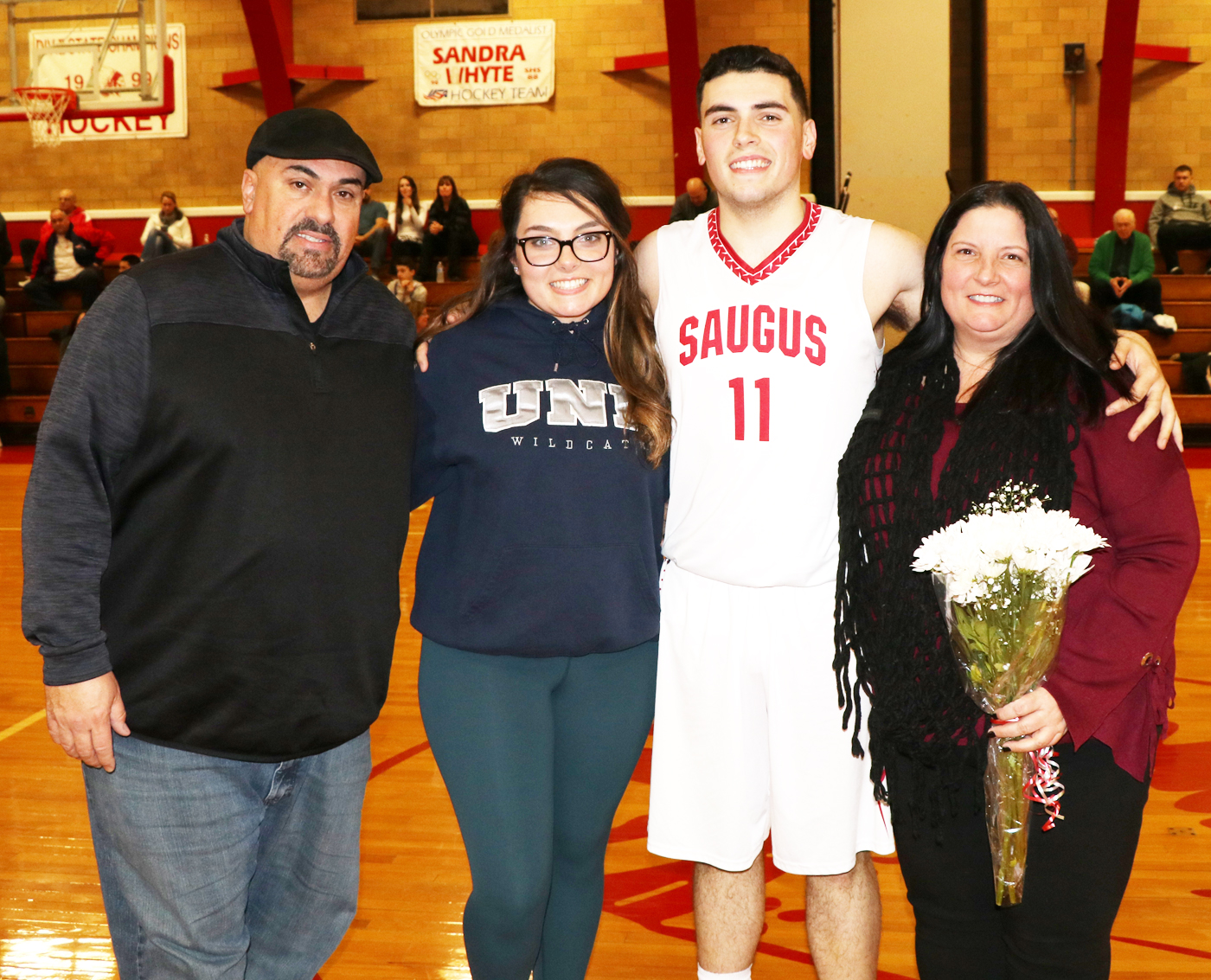 #11 Paul Stamatopoulos with his parents, Diana and Paul and Jenna.
