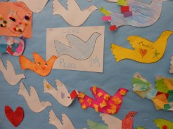 """VALENTINE'S DAY ART: The Saugus Public Library invites all of the town's children to share in the message of """"Love, Peace and Joy"""" by making a heart or dove and adding it to the bulletin board between now and Valentine's Day."""