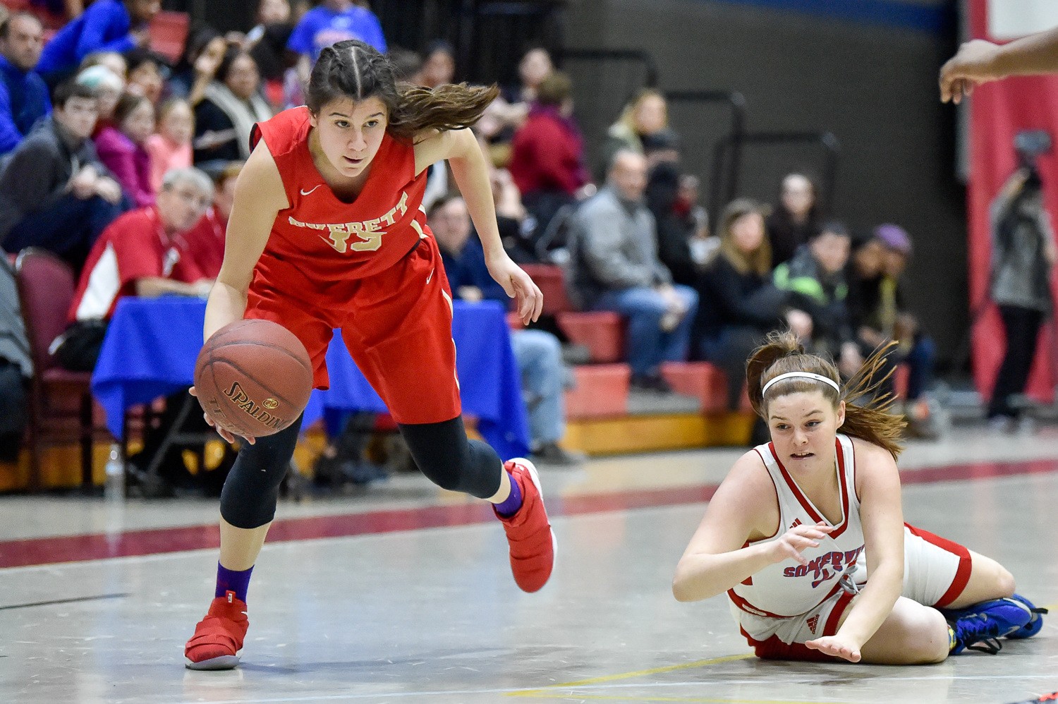 Carolann Cardinale of Everett takes control of a loose ball beating out a Somerville player during their game at Somerville High School on Tuesday, Feb. 13, 2018.