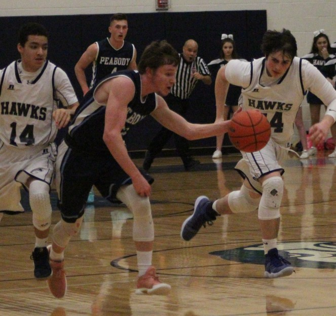Peabody's Marcus Barker takes off with a steal in Monday's victory.