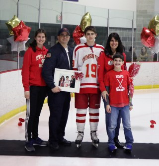 #19 Captain Jason Cardinale with his parents, Larry and Michelle; brother, Ryan; and sister, Carolann.